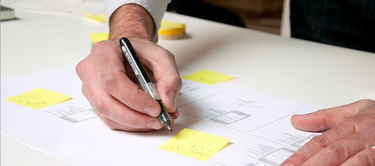 designer sketching a communication strategy